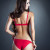 Rear view of flirting brunette in red lingerie