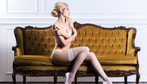 Young woman in bridal lingerie on a retro sofa