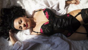 beautiful young woman lies on a bed in lingerie