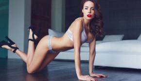 Sexy brunette woman in underwear posing on floor
